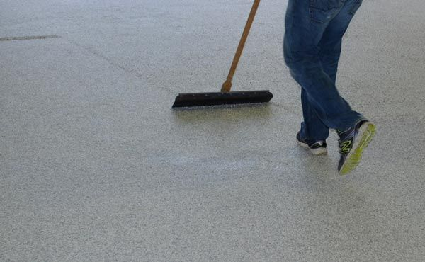 Scraping the flake on an EverMore Epoxy Garage Floor